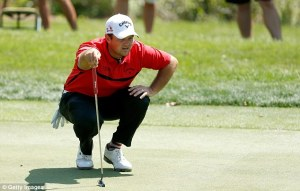 26AE755D00000578-0-Patrick_Reed_lines_up_a_putt_on_the_first_green_during_the_final-a-24_1426464508631